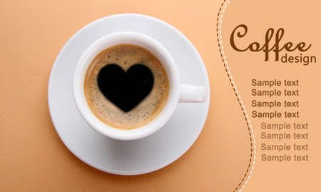 Cup of fresh coffee with heart sign photo