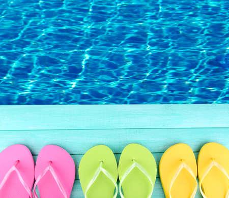 waterpool: Colored flip flops on wooden platform beside sea