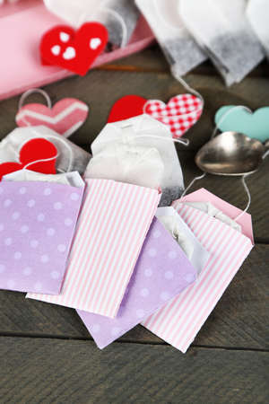 teabag: Heart shaped teabag tags on wooden background