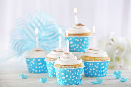birthday flowers: Delicious birthday cupcakes on table on light background Stock Photo