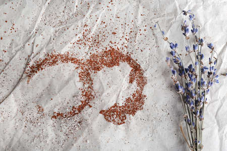 crumpled sheet: Traces of cocoa and sugar with dried flowers on crumpled sheet of paper background