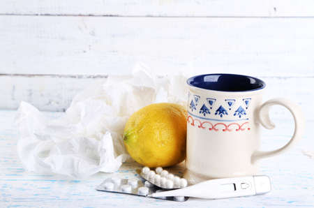 colds: Hot tea for colds, pills and handkerchiefs on table close-up