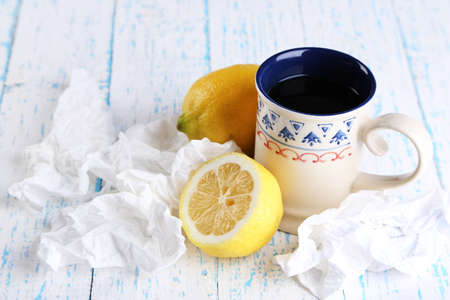 handkerchiefs: Hot tea for colds and handkerchiefs on table close-up Stock Photo
