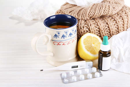cold: Hot tea for colds, pills and handkerchiefs on table close-up