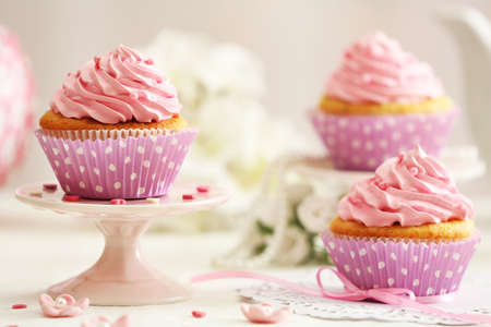 cupcakes: Delicious cupcakes on table on light background