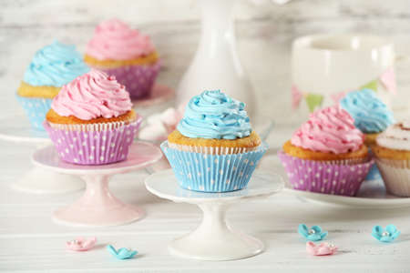 birthday cupcake: Delicious cupcakes on table on light background