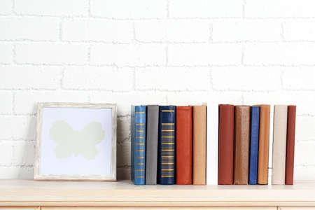 shelf: Books on shelf on wall background