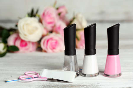 applicator: French manicure set with white tip polish, dividers and top coat shine applicator for nails on color wooden background Stock Photo