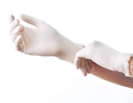 Doktor uvedení na sterilní rukavice izolovaných na bílém Reklamní fotografie