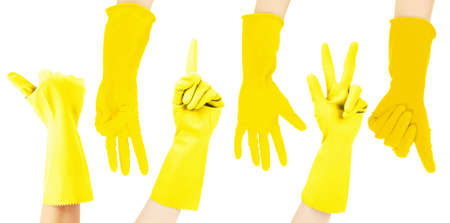 Hands in yellow gloves gesturing numbers isolated on white photo
