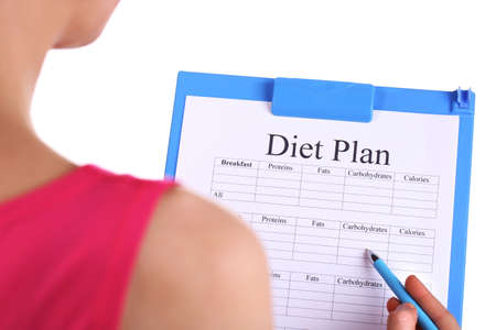 diet plan: Sports trainer with diet program isolated on white Stock Photo