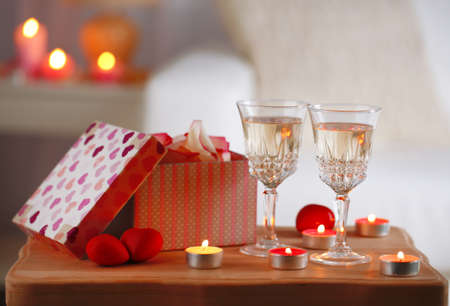 Champagne glasses and roses for celebrating Valentines Day photo