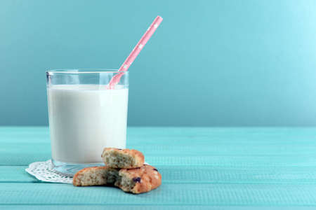 milk: Tasty cookies and glass of milk on color wooden background Stock Photo