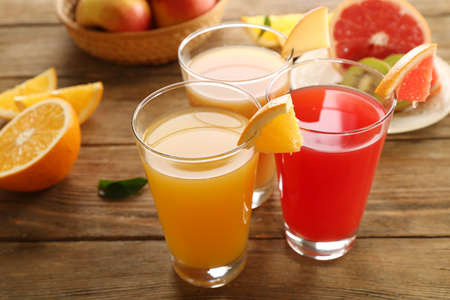 juice: Fresh juices with fruits on wooden table
