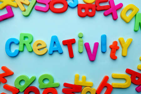 motto: Creativity motto by alphabet letters on colorful background