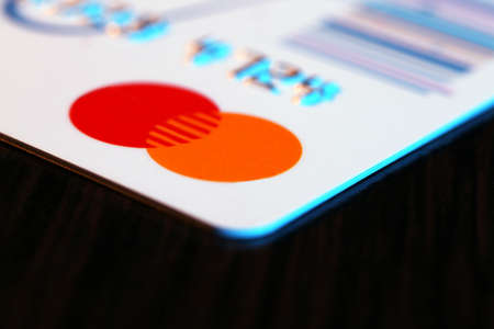 Credit card on wooden table background, macro photo