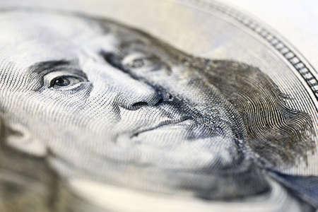 benjamin: Portrait of Benjamin Franklin on hundred dollar banknote, macro view Stock Photo