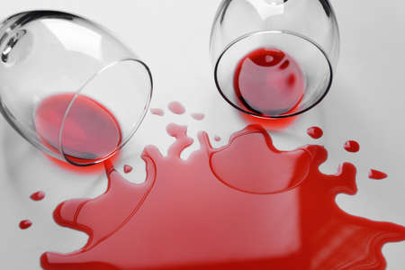 carpet stain: Red wine spilled from glass on white background Stock Photo