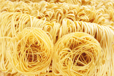 Different dry instant noodles close-up background photo