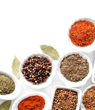 kinds: Different kinds of spices in ceramics bowls isolated on white