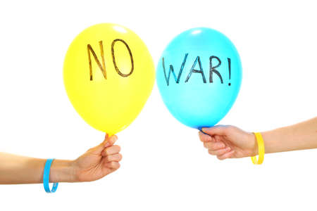 no war: Hands holding blue and yellow balloons - no war concept