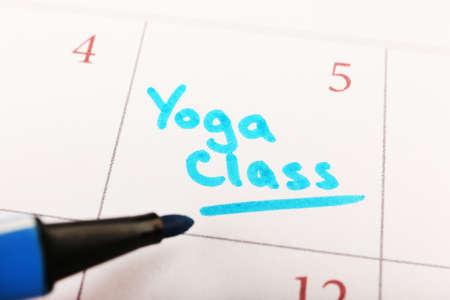 Written plan Yoga Class on calendar page background photo