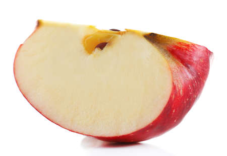at close quarters: Cut red apple isolated on white