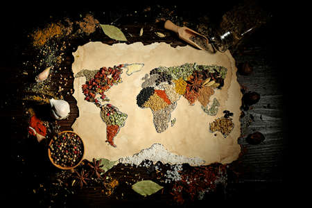kinds: Map of world made from different kinds of spices on wooden background
