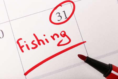Written plan Fishing on calendar page background