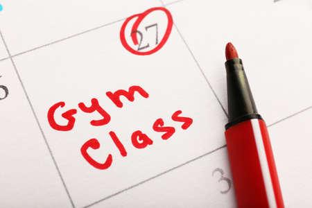 Written plan Gym Class on calendar page background photo