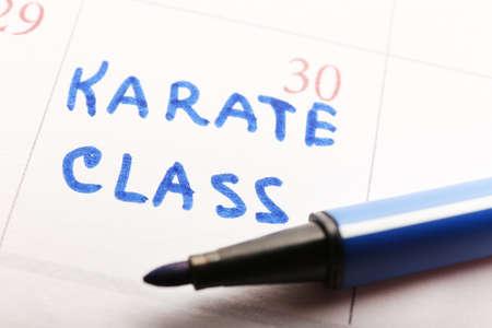 Written plan Karate Class on calendar page background photo
