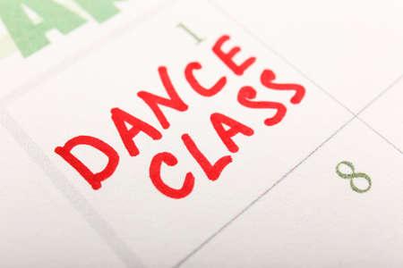 Written plan Dance Class on calendar page background photo