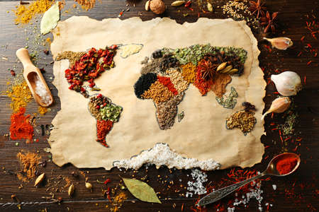 spice: Map of world made from different kinds of spices on wooden background