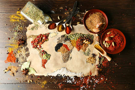 curry spices: Map of world made from different kinds of spices on wooden background