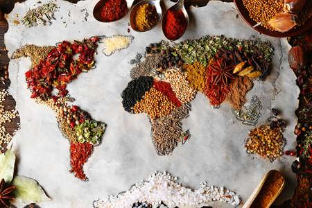 recurso: Mapa de mundo feito a partir de diferentes tipos de especiarias, close-up Imagens