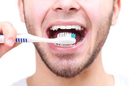 Man with toothbrush isolated on white photo