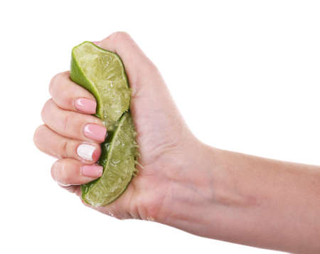 squeezing: Female hand squeezing lime isolated on white