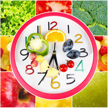 microelements: Food clock with vegetables and fruits as background. Healthy food concept