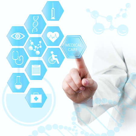 Medical doctor working with healthcare icons. Modern medical technologies concept 스톡 콘텐츠