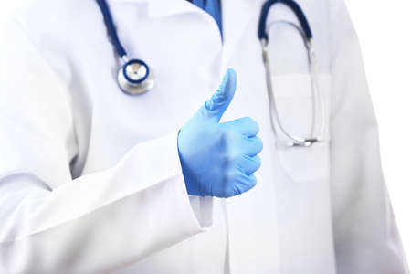 all right: Doctor with stethoscope and gloves showing all right sign on white background