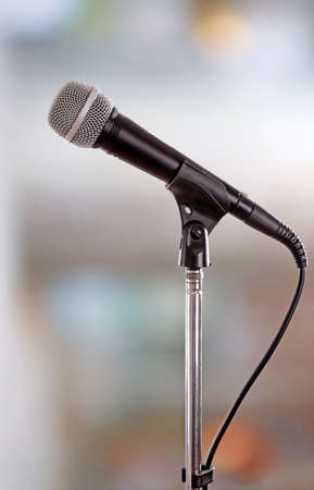 amplified: Microphone on stand on light background