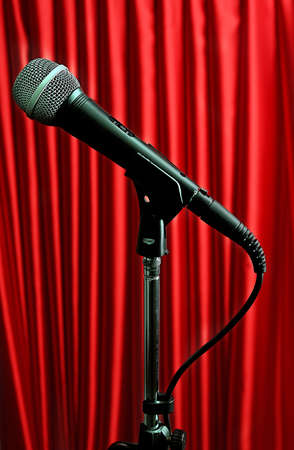 39390907-microphone-on-stand-on-red-curtain-background.jpg