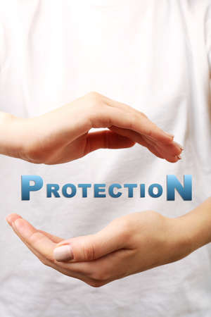 health care provider: Female hands with word protection on light background Stock Photo