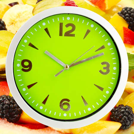 microelements: Food clock with fruits as background. Healthy food concept Stock Photo
