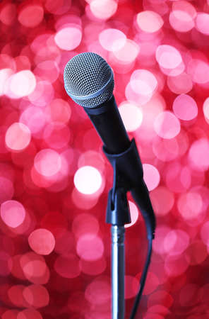 amplified: Microphone on stand on red background