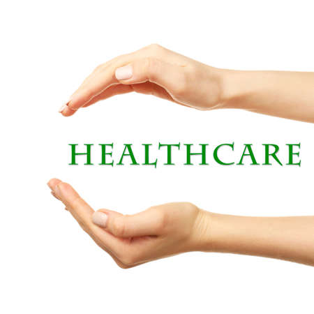 health care funding: Female hands with health care words isolated on white