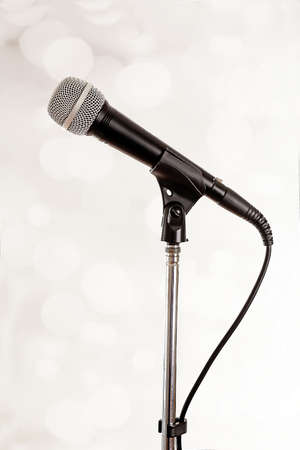 singer with microphone: Microphone on stand on light background