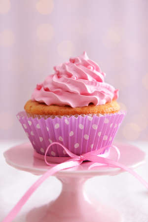 party background: Sweet cupcake on table on light background