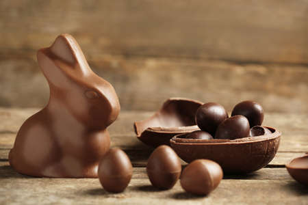Chocolate Easter Eggs on wooden background Stock Photo