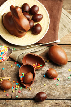 Chocolate Easter Eggs on wooden background photo